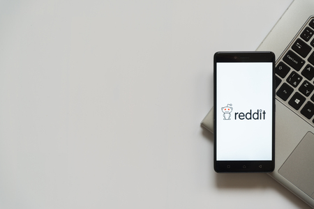 Bratislava, Slovakia, April 28, 2017: Reddit logo on smartphone screen placed on laptop keyboard. Empty place to write information.