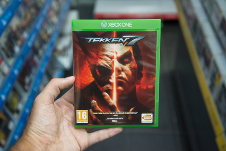 Bratislava, Slovakia, circa april 2017: Man holding Tekken 7 videogame on Microsoft XBOX One console in store