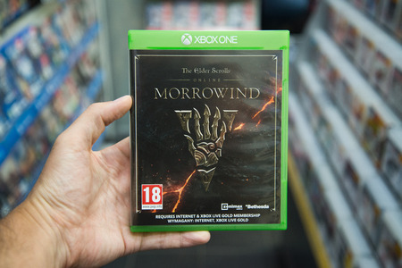 Bratislava, Slovakia, circa april 2017: Man holding The Elder Scrolls online Morrowind videogame on Microsoft XBOX One console in store