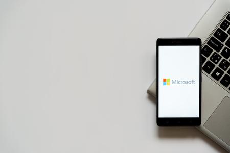 Bratislava, Slovakia, April 28, 2017: Microsoft logo on smartphone screen placed on laptop keyboard. Empty place to write information. Editorial