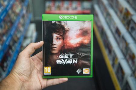 Bratislava, Slovakia, circa april 2017: Man holding Get Even videogame on Microsoft XBOX One console in store Stock Photo - 79772575