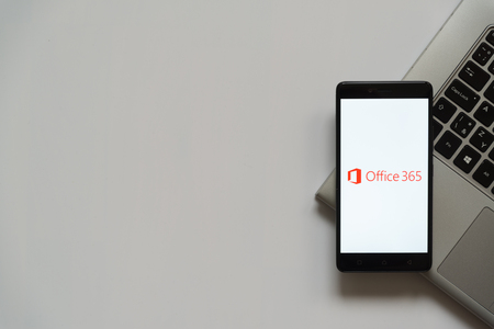 Bratislava, Slovakia, April 28, 2017: Microsoft Office 365 logo on smartphone screen placed on laptop keyboard. Empty place to write information.