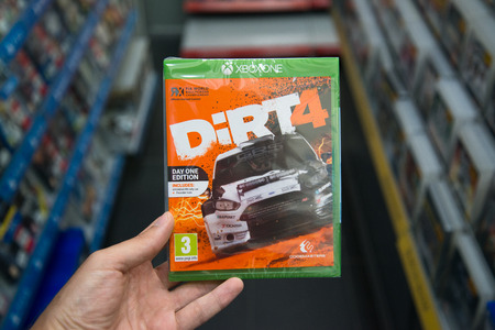 Bratislava, Slovakia, june 15, 2017: Man holding Dirt 4 videogame on Microsoft XBOX One console in store