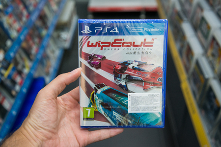 bratislava: Bratislava, Slovakia, june 15, 2017: Man holding Wipeout videogame on Playstation 4 console in store