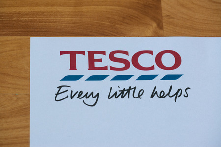 LONDON, United Kingdom, June 28, 2017: A close-up of the Tesco logo and slogan on a promotional paper