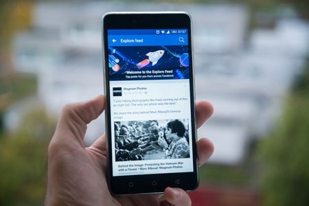 San Francisco, october 10, 2017: New second facebook timeline explore feed on mobile phone Editoriali