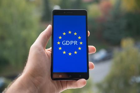 Regulación general de protección de datos (GDPR) en teléfonos móviles Foto de archivo - 88897088