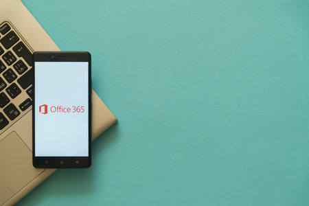 Los Angeles, USA, october 19, 2017: Microsoft office 365 logo on smartphone placed on laptop keyboard. Empty copyscape place on green background to write information. Éditoriale