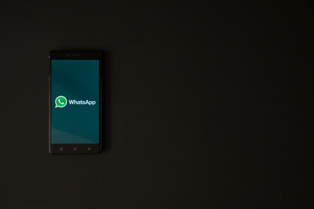 Los Angeles, USA, october 19, 2017: Whatsapp logo on smartphone screen on black background. Éditoriale