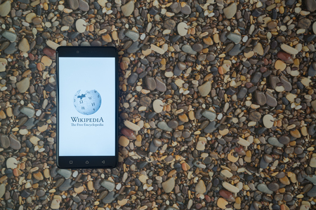 wiki wikipedia: Los Angeles, USA, october 18, 2017: Wikipedia logo on smartphone on background of small stones Editorial