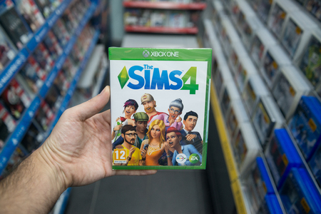 Bratislava, Slovakia, december 1, 2017: Man holding The sims 4 videogame on Microsoft XBOX One console in store Stock Photo - 91065619