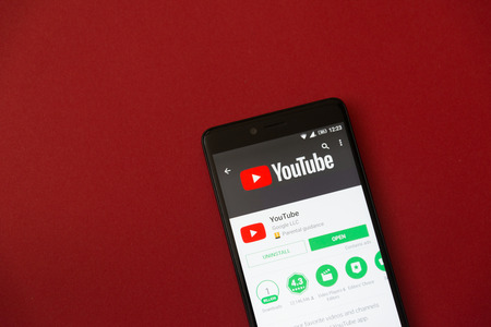 Los Angeles, december 11, 2017: Smartphone with Youtube application in google play store on red background