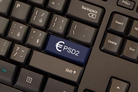 Directiva de Serviços de Pagamento 2 (PSD2) no botão do teclado Foto de archivo - 93064480