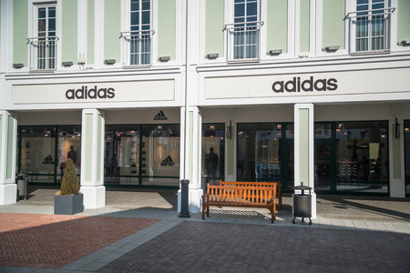 Parndorf, Austria, february 15, 2018: Adidas store in Parndorf, Austria. Adidas is a multinational corporation, founded and headquartered in Herzogenaurach, Germany by Adolf Dassler. Editorial