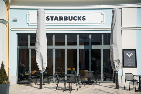 Parndorf, Austria, february 15, 2018: Starbucks store in Parndorf, Austria. Starbucks Corporation is an American coffee company that operates 27,339 locations worldwide (2017). Editorial