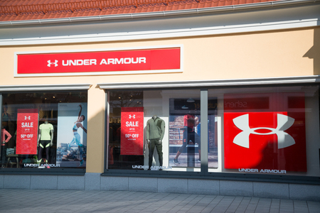 Parndorf, Austria, february 15, 2018: Under Armour store in Parndorf, Austria. Under Armour is an American company that manufactures footwear, sports and casual apparel. Founded in 1966 by Kevin Plank Editorial