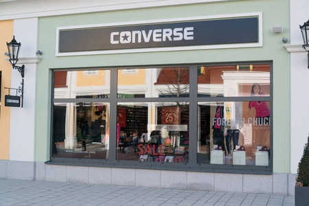 Parndorf, Austria, february 15, 2018: Converse store in Parndorf, Austria. Converse is an American shoe company that primarily produces basketball shoes and lifestyle brand footwear and apparel. Éditoriale