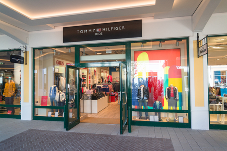 Parndorf, Austria, february 15, 2018: Tommy Hilfiger Kids store in Parndorf, Austria. Tommy Hilfiger is an American multinational corporation founded in 1985. Editorial