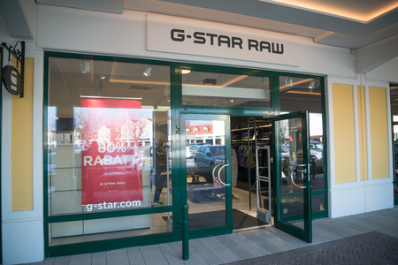 Parndorf, Austria, february 15, 2018: G-Star Raw store in Parndorf, Austria. is a Dutch designer clothing company, founded by Jos van Tilburg in Amsterdam in 1989, which produces urban clothing. Editorial
