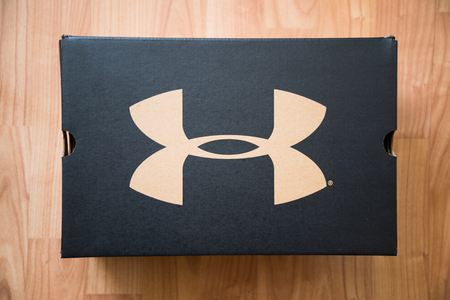 Nitra, Slovakia, february 22, 2018: Under armour shoes box on wooden background Editorial