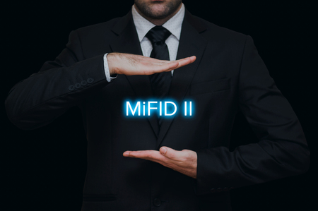 Markets in Financial Instruments Directive (MiFID II) with businessman gesture on black background