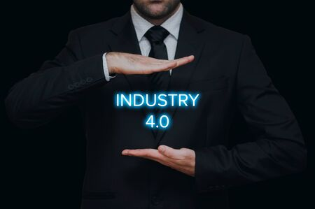Industry 4.0 concept with businessman on black background