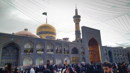 Mashhad, Iran, may 13, 2018: Haram comple and the Imam Reza Shrine, the largest mosque in the world by dimension in the holiest city in Iran - Mashhad.