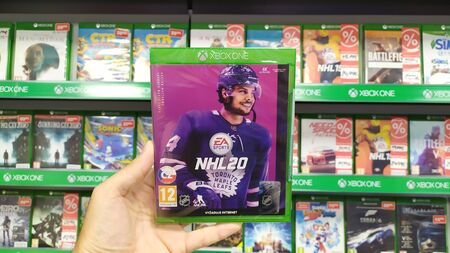 Bratislava, Slovakia, september 18, 2019: Man holding Fifa 20 videogame on Microsoft XBOX One console in store