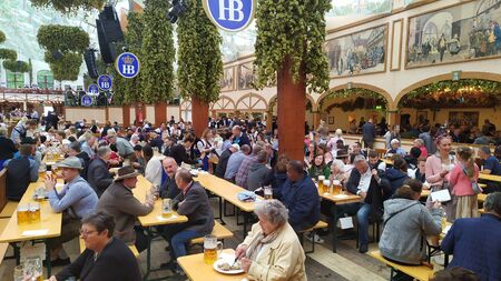 Munich, Germany, september 23, 2019 People from all over the world attending Oktoberfest 2019 in Theresienwiese area, Munich, Germany Redakční