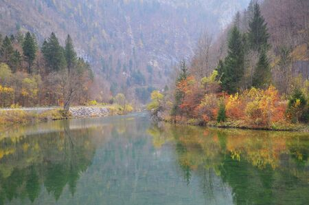 Beautiful lake with mirror reflection of autumn scenery at Slovenia.