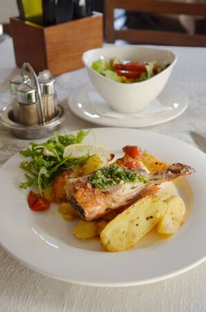 Pan fried local catch fish at Ljubljana cafe, with salt and pepper potatoes and salad.