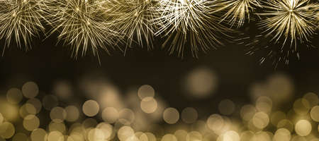 Abstract background for Christmas, New Year, Holiday. Golden Fireworks and Golden Bokeh with golden background. Copy space and Panoramic horizontal design. Stok Fotoğraf
