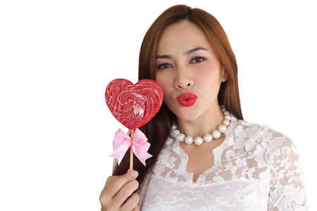 woman happy in candy shape heart on isolate photo