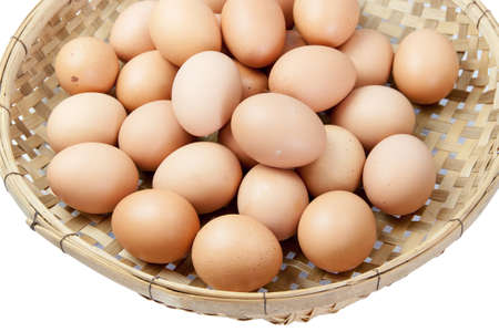 winnowing: eggs in the winnowing basket. On white background. Stock Photo