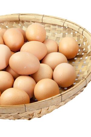 winnowing: Eggs in the winnowing basket. On white background.