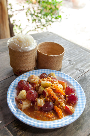 somtum: Thailand style fruit salads mixed fresh fruit with sauce tastes sour salty sweet.to eat with sticky rice.