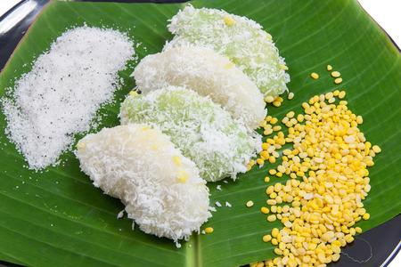 Close up mung bean rice - crepe on banana leaves and black ceramic dish. Dessert thailand.