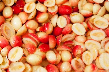 hemispherical: Carunda herbal fruit cut hemispherical fermented in brine Stock Photo