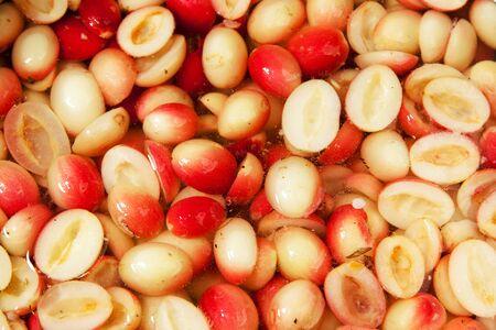 hemispherical: Carunda herbal fruit cut hemispherical picking seeds out fermented in brine Stock Photo