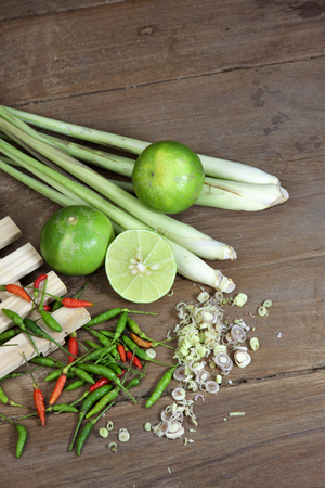 raw food: Component cooking Thai Tom Yam soup herbs and spices on wood table Stock Photo