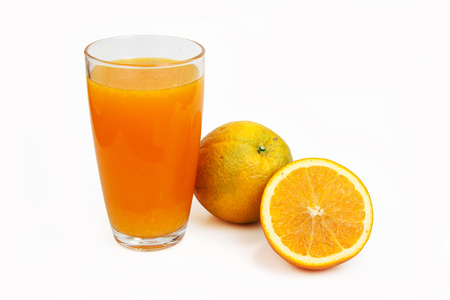 naranja fruta: Orange juice in clear glass and orange fruit on isolated white with clipping path Foto de archivo