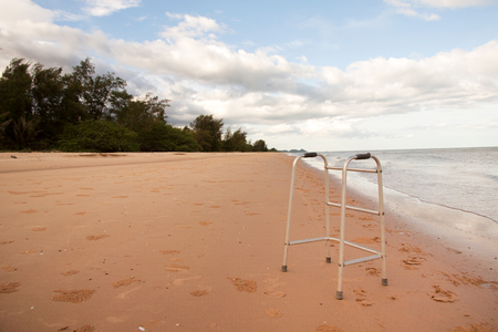 convey: walker on sand beach. convey in meaning the relax tourist attractions of the elderly.