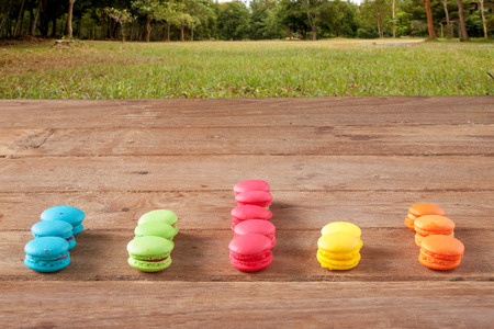 bisiness: arranged in a bar graph colorful french Macaroon on wood in nature background Stock Photo