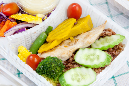 meat and alternatives: Chicken with garlic and pepper and vegetable salad thai cuisine put in a modern plastic box. choose on focus