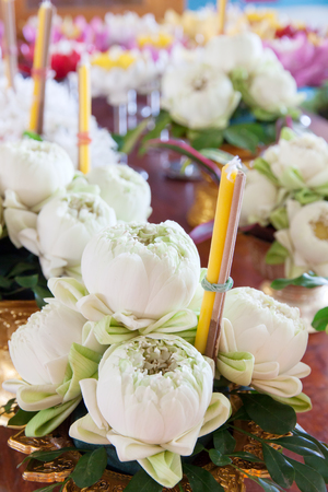 focus in foreground: candles and  lotus flower and incense for worshiping the Buddha. Focus On Foreground.