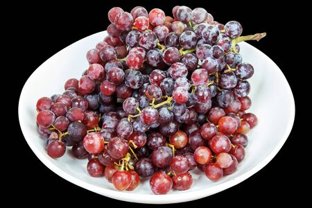 seedless: Seedless red grapes many and freshness on background with clipping Paths Stock Photo