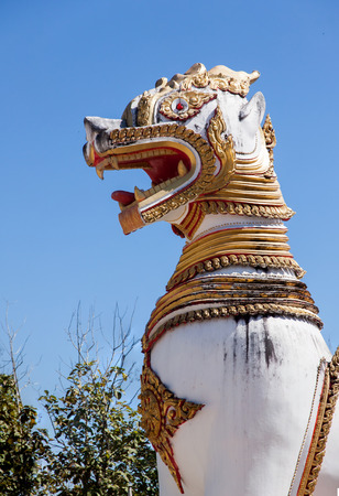 believing: Singha, holy lion in buddhism. Believing it beware and watch out buddhism from evil. Take photo from Wat in Kanchanaburi, Thailand.