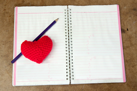 note book: Crochet heart red color and pencil on note book