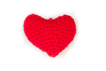 love image: Crochet heart red color on white background