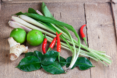 thailand food: Ingredients for hot and sour Thai soup, Tom Yum Koong. On wood. Stock Photo
